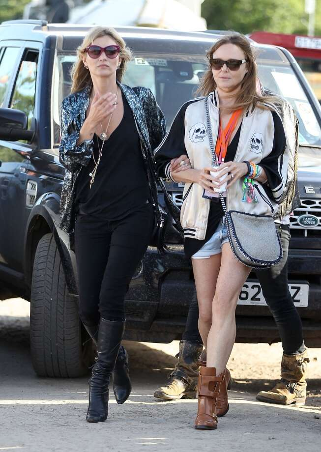 GLASTONBURY, ENGLAND - JUNE 29:  Kate Moss and Stella McCartney attends day 3 of the 2013 Glastonbury Festival at Worthy Farm on June 29, 2013 in Glastonbury, England.  (Photo by Danny Martindale/WireImage)