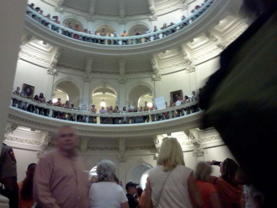 2:56 The rotunda is still filled with screaming people. Officers are standing by the doors, monitoring the flow of people in and out. They have begun to turn people away, stating the area is full. Photo: Emily Bamforth Photo: Express-News