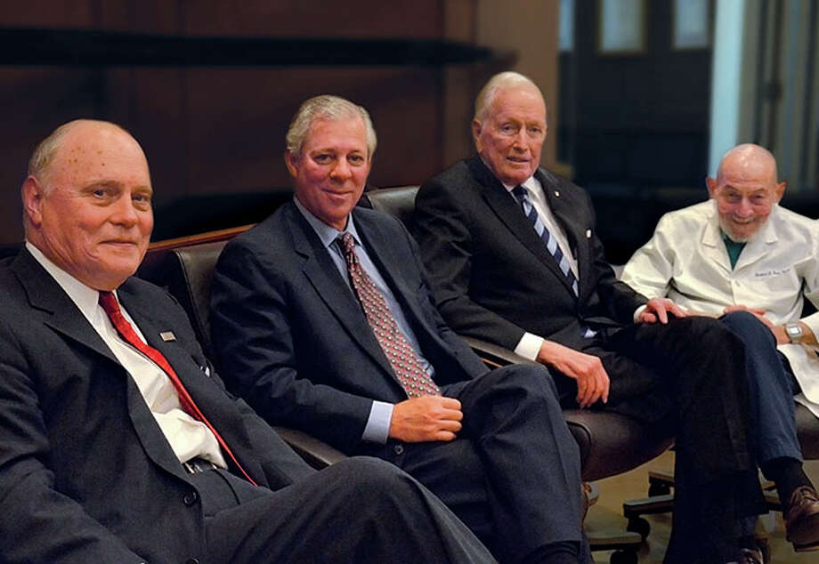 From left, Dr. Max Buja, executive director of the Texas Medical Center Library; Dr. Robert Robbins, medical center president; Texas Heart Institute founder Dr. Denton Cooley and Dr. Herbert Fred are shown at a reception celebrating Cooley's donation. Photo: Courtesy Of Texas Medical Center Ken Hoge