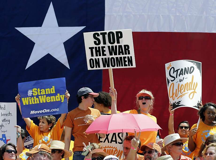 Pro-abortion rights supporters cheer during a rally outside the Texas capitol, Monday, July 1, 2013, in Austin, Texas. The Texas Senate has convened for a new 30-day special session to take up contentious abortion restrictions bill and other issues. (AP Photo/Eric Gay) Photo: Eric Gay, Associated Press
