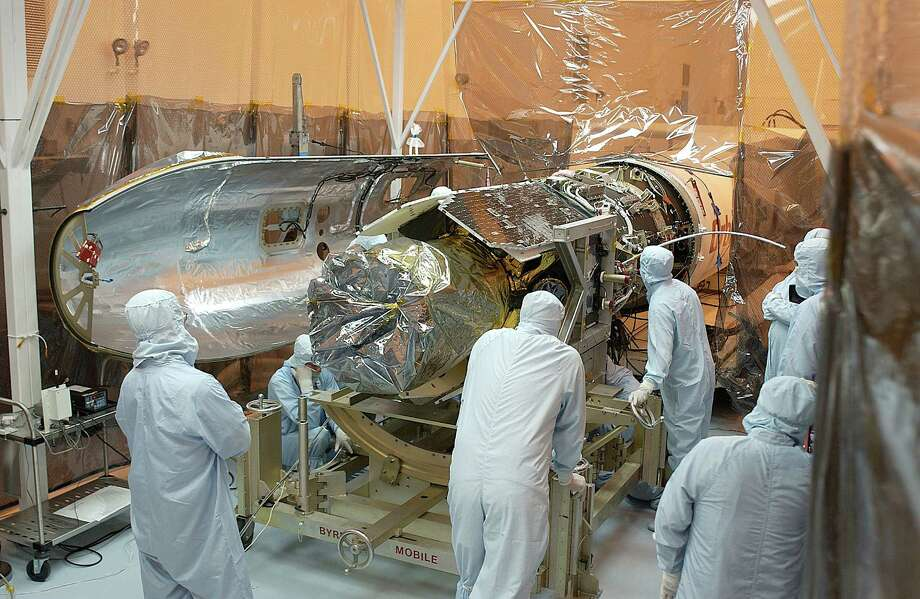 Technicians prepare the Galaxy Evolution Explorer on April 7, 2003 at Kennedy Space Center, Florida. Photo: Getty Images / NASA