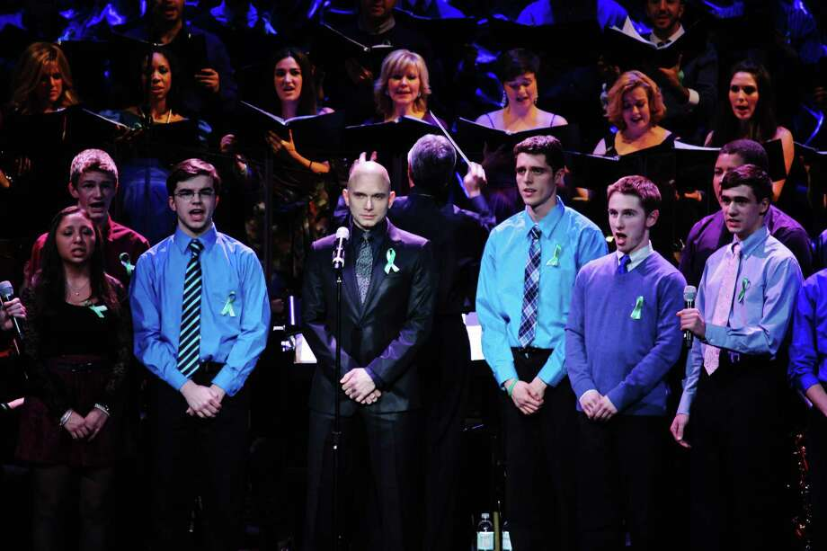 "Tony-winning Broadway star Michael Cerveris (center), performs with members of the Newtown High School Chamber Choir, at the ""From Broadway With Love"" benefit at the Palace Theater in Waterbury on Jan. 28. CPTV and other regional public television outlets will broadcast a special about the event starting Thursday, July 18. Photo: Contributed Photo"