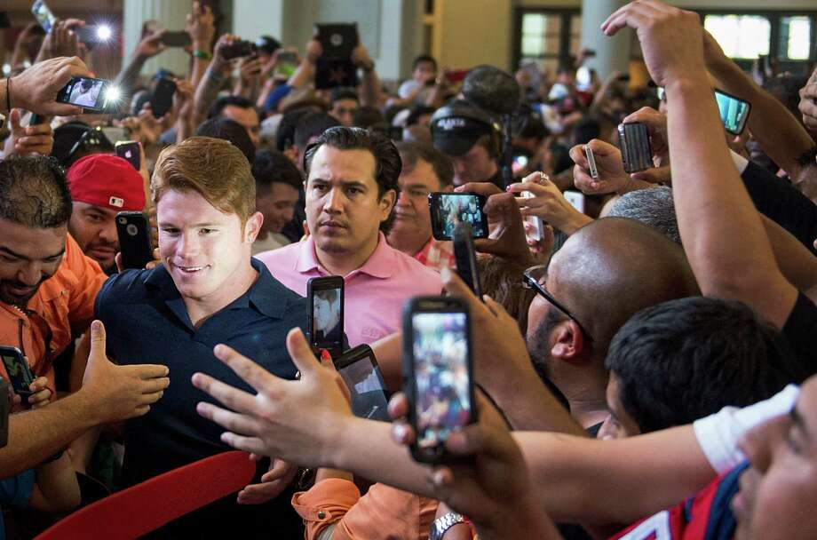 Boxer Canelo Alvarez makes his way through the crowd as he arrives for a promotional event at Minute Maid Park. Photo: Smiley N. Pool, Houston Chronicle / © 2013  Houston Chronicle