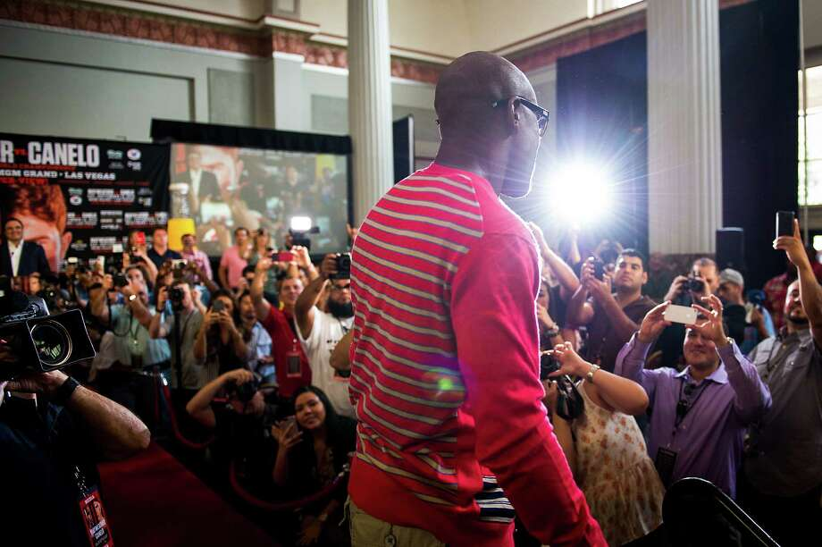 Boxer Floyd Mayweather makes his way through the crowd as he arrives for a promotional event at Minute Maid Park. Photo: Smiley N. Pool, Houston Chronicle / © 2013  Houston Chronicle