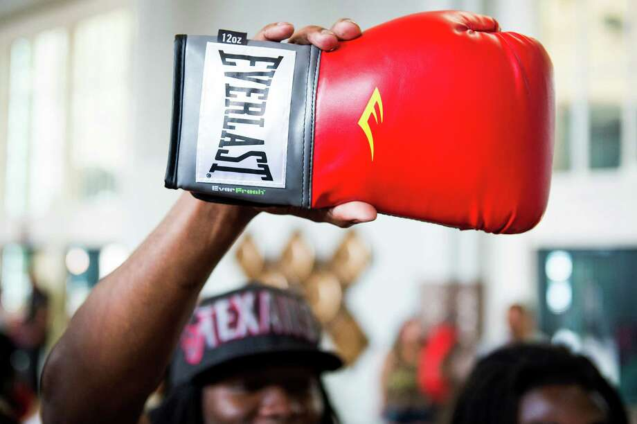 A fan holds up a boxing clove hoping for an autograph. Photo: Smiley N. Pool, Houston Chronicle / © 2013  Houston Chronicle