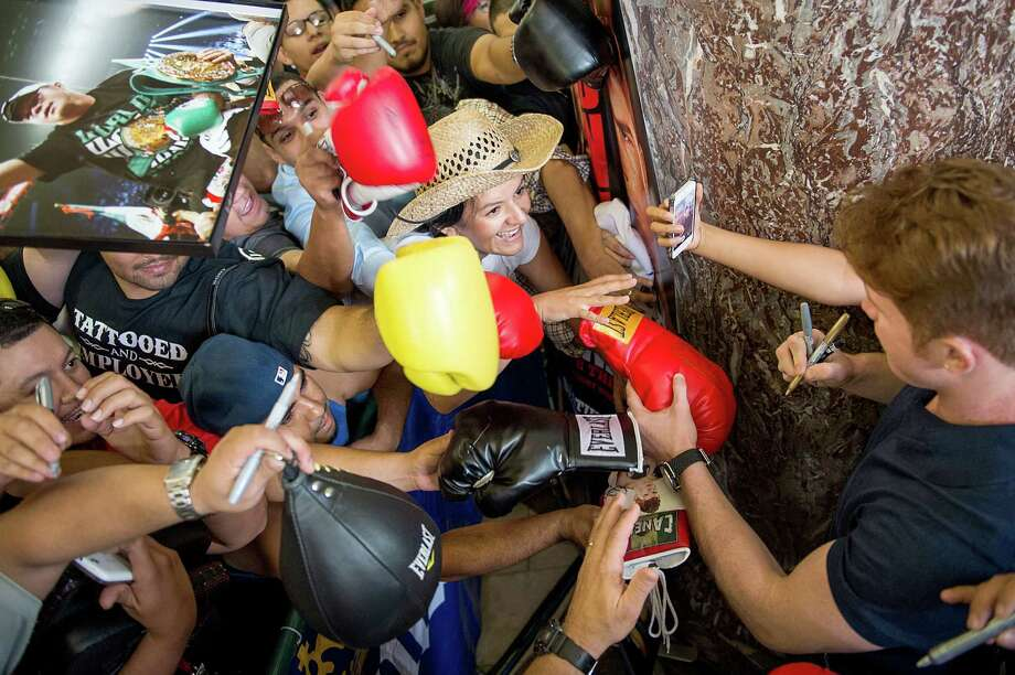 Fans push forward to get an autograph from boxer Canelo Alvarez during a promotional event at Minute Maid Park. Photo: Smiley N. Pool, Houston Chronicle / © 2013  Houston Chronicle