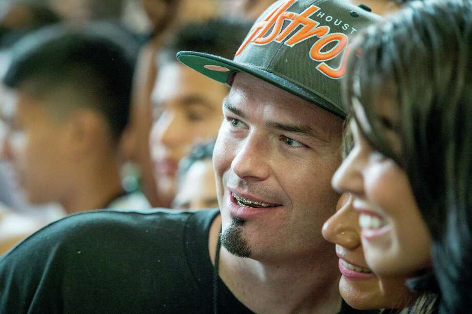 Rapper Paul Wall poses for photos with boxing fans. Photo: Smiley N. Pool, Houston Chronicle / © 2013  Houston Chronicle