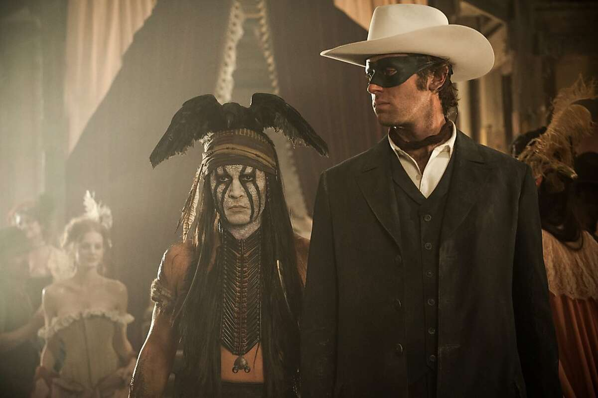 """""""THE LONE RANGER"""" L to R: Johnny Depp as Tonto and Armie Hammer as The Lone Ranger"""