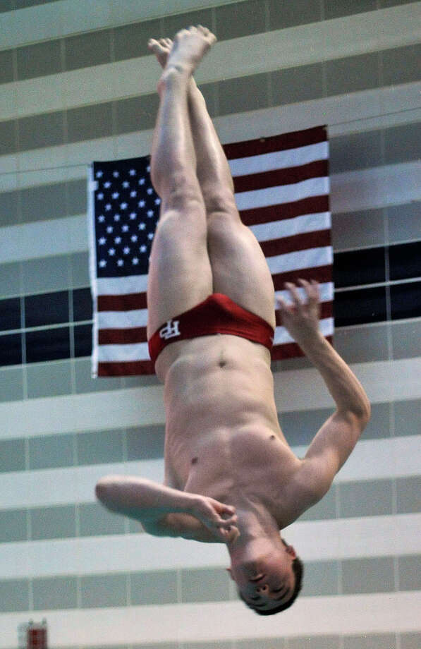 Fairfield Prep's Jake Bowtell competes in the state open diving finals at Middletown High School on Thursday, March14, 2013. Photo: Jason Rearick / The Stamford Advocate