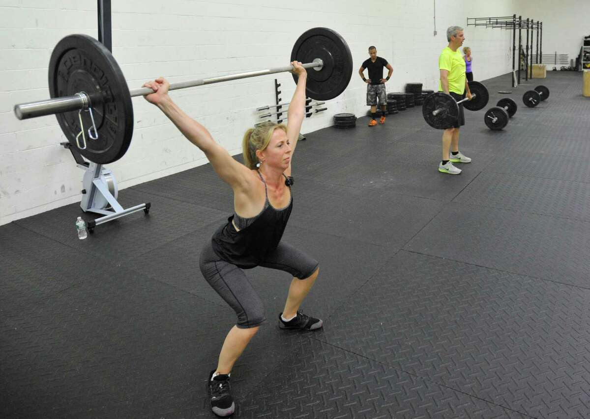 Iron Resolve CrossFit - StamfordWebsite Pictured: Jessica Baker lifts performs a clean and jerk during a one-hour Crossfit workout session at Iron Resolve Crossfit in Stamford on Monday, June 24, 2013.