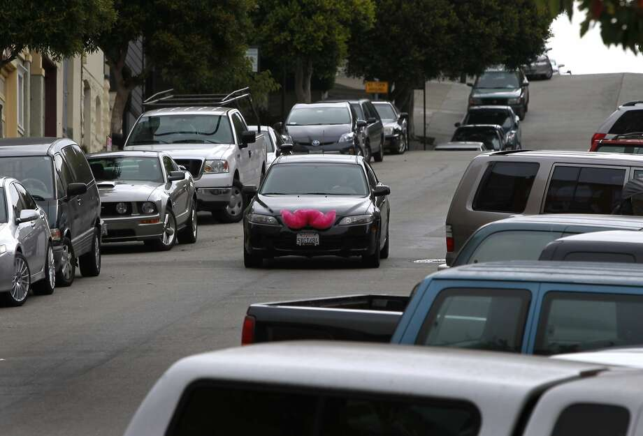 Yev Kaplinesky drives his car decorated with a pink moustache for the Lyft passenger service in the North Beach neighborhood in San Francisco, Calif. on Wednesday, Sept. 5, 2012. Photo: Paul Chinn, The Chronicle