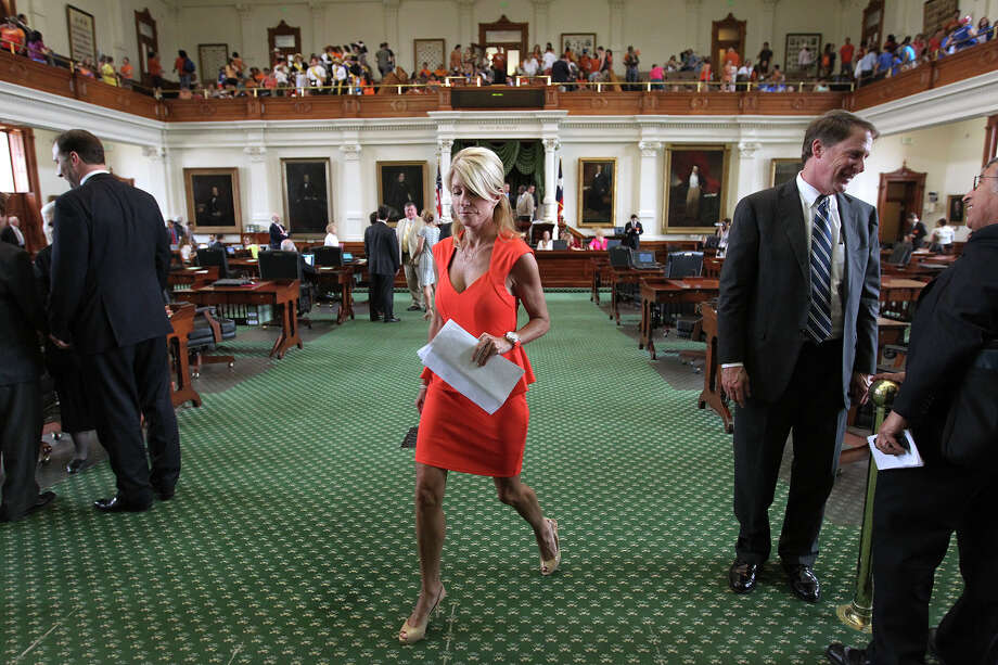 Sen. Wendy Davis, D-Fort Worth, walks out of the Senate Chambers after it adjourned on the first day of a second special session, Monday, July 1, 2013. The Senate will return on July 9 and will tackle the controversial anti-abortion bill. Photo: Jerry Lara, San Antonio Express-News / ©2013 San Antonio Express-News