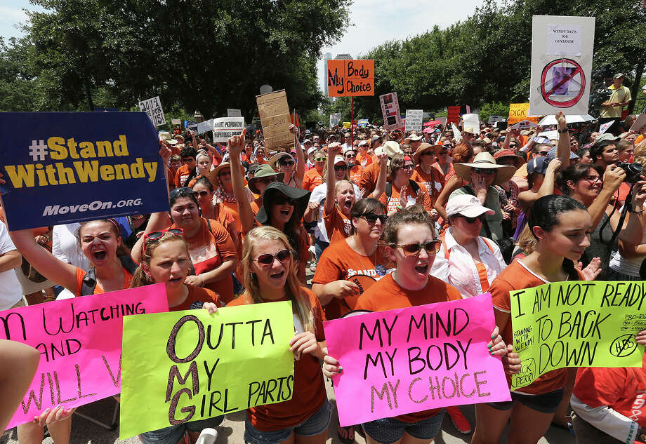 Thousands of supporters attend the Stand Up For Texas Women Rally at State Capitol before the start of the second legislative special session, Monday, July 1, 2013. The rally was in protest against a controversial anti-abortion bill. Photo: Jerry Lara, San Antonio Express-News / ©2013 San Antonio Express-News