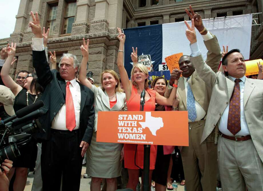 Texas Sen. Wendy Davis (D-Ft. Worth) is surrounded by supporting Texas representatives and senators after leading a rally in support of Texas women's right to reproductive decisions at the Texas state capitol on July 1, 2013 in Austin, Texas. This is first day of a second legislative special session called by Texas Gov. Rick Perry to pass an restrictive abortion law through the Texas legislature. The first attempt was defeated after opponents of the law were able to stall the vote until after first special session had ended. Photo: Erich Schlegel, Getty Images / 2013 Getty Images