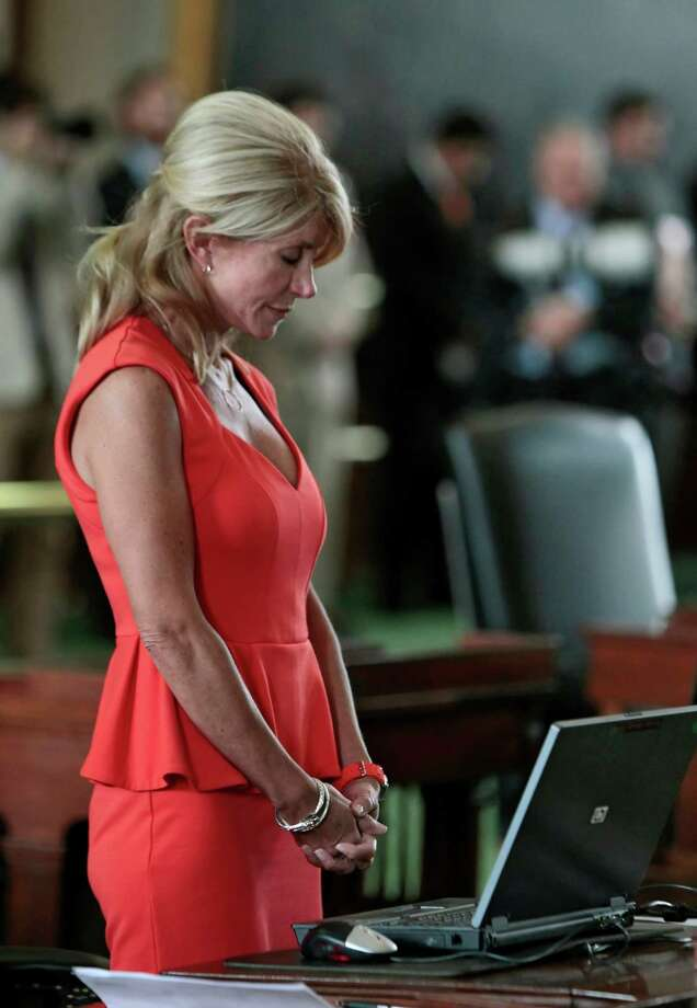 Texas Sen. Wendy Davis (D-Ft. Worth) bows her head in prayer on the first day of the second legislative special session on July 1, 2013 in Austin, Texas. This is first day of a second legislative special session called by Texas Gov. Rick Perry to pass an restrictive abortion law through the Texas legislature. The first attempt was defeated after opponents of the law were able to stall the vote until after first special session had ended. Photo: Erich Schlegel, Getty Images / 2013 Getty Images