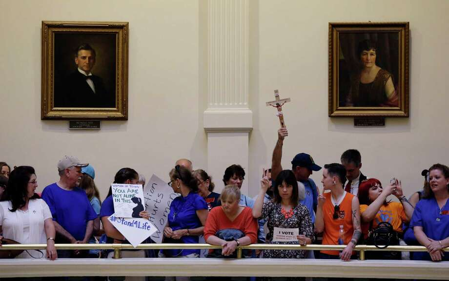 Anti-abortion supporters and pro-abortion rights supporters crowd into the rotunda of the Texas capitol, Monday, July 1, 2013, in Austin, Texas. The Texas Senate has convened for a new 30-day special session to take up contentious abortion restrictions bill and other issues. Photo: Eric Gay, Associated Press / AP