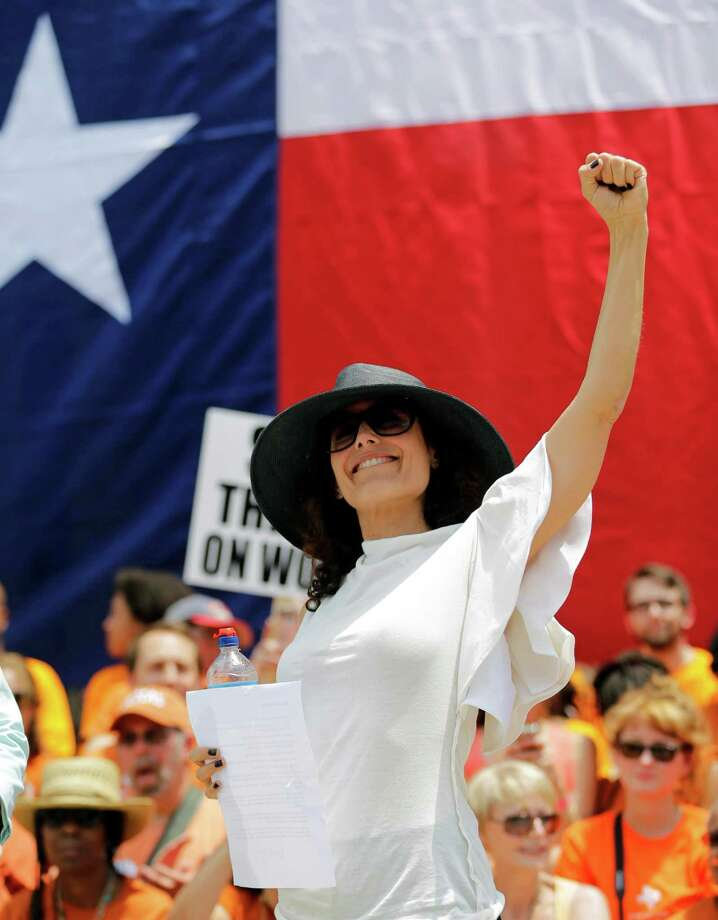Actress Lisa Edelstein pumps her fist as she attends a rally supporting abortion rights outside the Texas Capitol, Monday, July 1, 2013, in Austin, Texas. The Texas Senate has convened for a new 30-day special session to take up contentious abortion restrictions bill and other issues. Photo: Eric Gay, Associated Press / AP