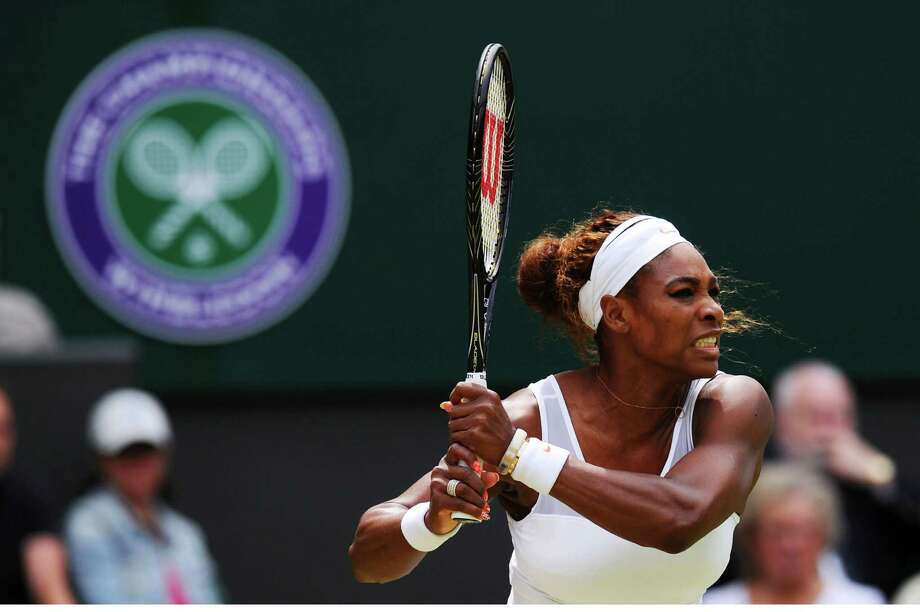 LONDON, ENGLAND - JULY 01:  Serena Williams of United States of America plays a backhand during her Ladies' Singles fourth round match against Sabine Lisicki of Germany on day seven of the Wimbledon Lawn Tennis Championships at the All England Lawn Tennis and Croquet Club on July 1, 2013 in London, England.  (Photo by Mike Hewitt/Getty Images) ORG XMIT: 168810652 Photo: Mike Hewitt / 2013 Getty Images