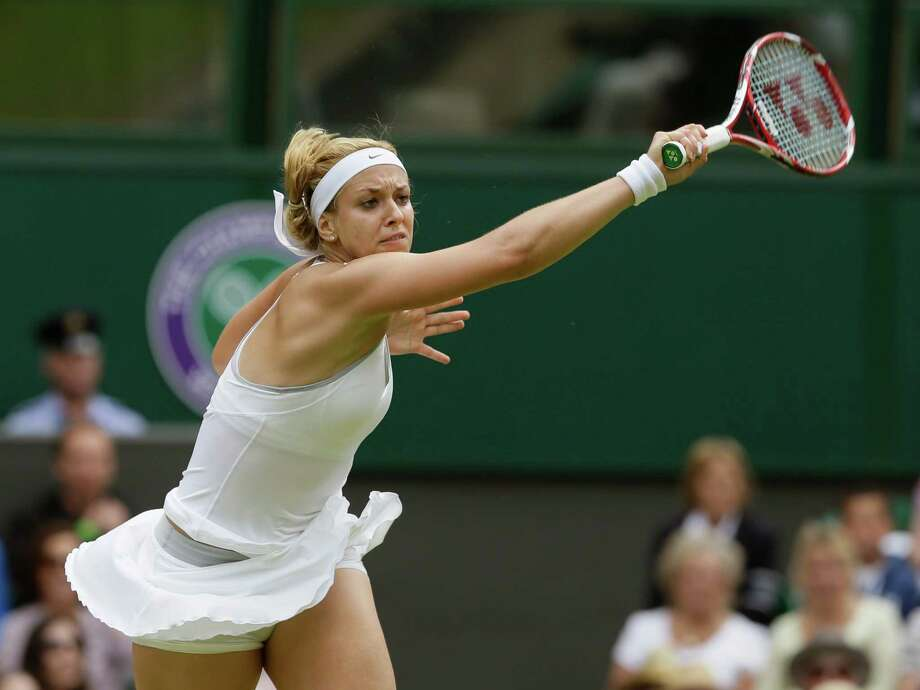Sabine Lisicki of Germany returns to Serena Williams of the United States in a Women's singles match at the All England Lawn Tennis Championships in Wimbledon, London, Monday, July 1, 2013. (AP Photo/Alastair Grant)  ORG XMIT: WIM189 Photo: Alastair Grant / AP