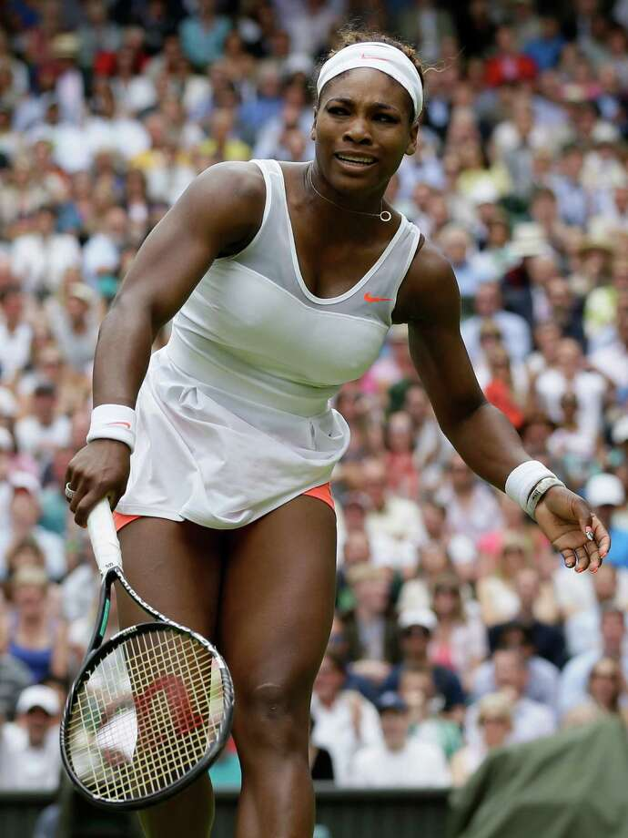 Serena Williams of the United States reacts as she plays Sabine Lisicki of Germany in a Women's singles match at the All England Lawn Tennis Championships in Wimbledon, London, Monday, July 1, 2013. (AP Photo/Alastair Grant)  ORG XMIT: WIM190 Photo: Alastair Grant / AP