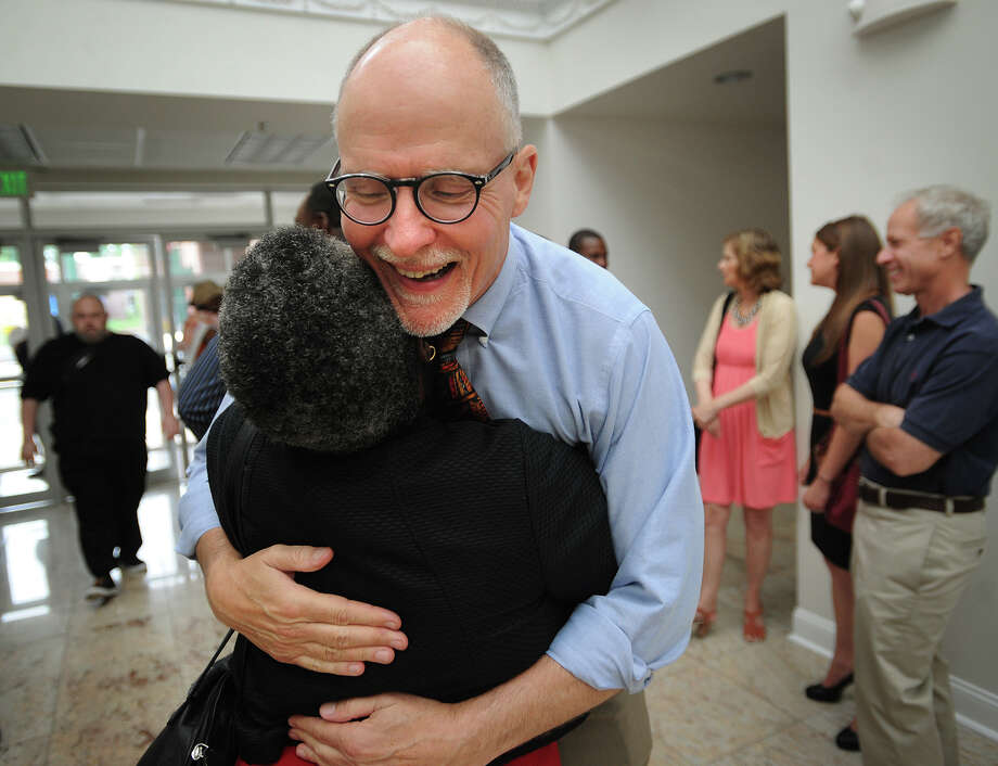 Former Bridgeport Supt. of Schools Paul Vallas is hugged by Prophetess Gerry Claytor as he arrives at a rally supporting him at the Cathedral of the Holy Spirit at 790 Union Avenue in Bridgeport, Conn. on Monday, July 1, 2013. The church is pastored by Bridgeport Board of Education Chairman Kenneth Moales, Jr. Photo: Brian A. Pounds / Connecticut Post