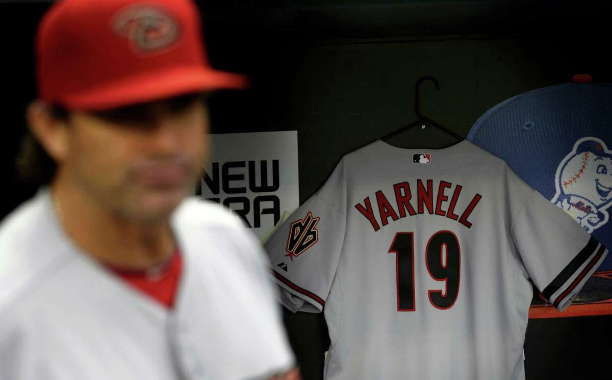 A jersey honoring the 19 firefighters who died in the wildfire in Yarnell, Ariz., hangs in the Arizona Diamondback's dugout before the baseball game against the New York Mets at Citi Field, Monday, July 1, 2013, in New York. (AP Photo/Seth Wenig)