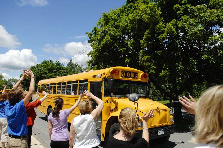 Teachers and staff from Division Street Elementary School line the sidewalk to wave goodbye to students on buses on the final day of school Wednesday, June 24, 2009, inSaratoga Springs, N.Y.   (Paul Buckowski / Times Union archive) Photo: PAUL BUCKOWSKI / 00004433A