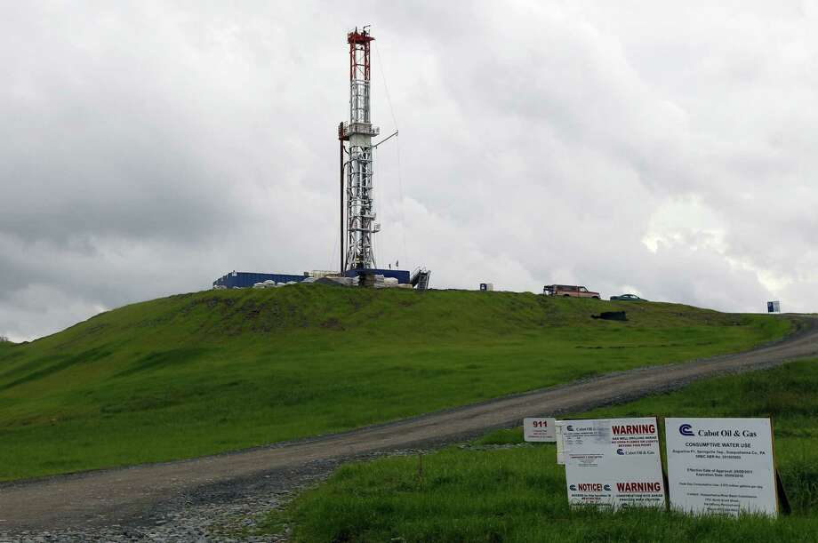 A drilling rig works in Pennsylvania in 2011. Rig counts have declined in U.S. shale plays, and many producers have shifted their strategy more to liquids-rich plays. But natural gas production has remained stable. Photo: Associated Press File Photo
