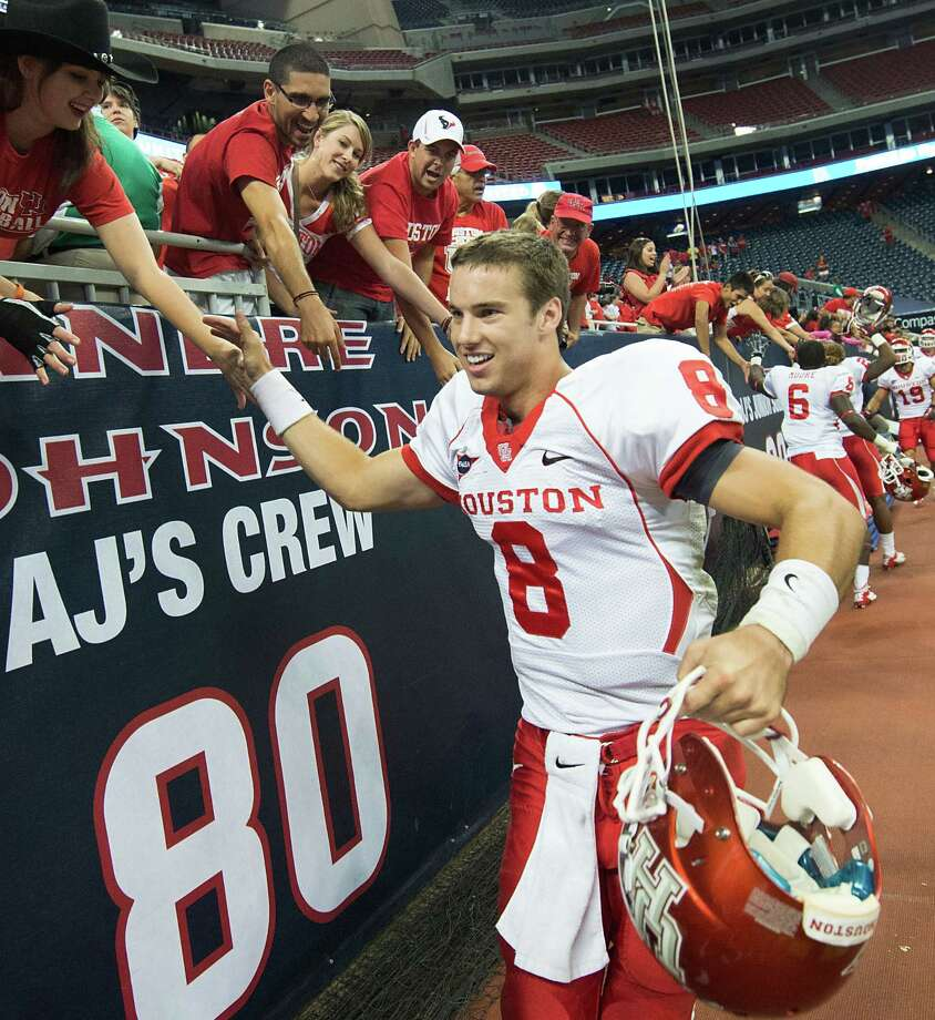 Quarterback David Piland and the Cougars hope to forge more good memories of Reliant Stadium after beating Rice there in 2012. In 2013, UH again will play Rice at Reliant in the Bayou Bucket game and also will play four home games there while the school's new on-campus stadium is being constructed. Photo: Smiley N. Pool, Staff / © 2012  Houston Chronicle