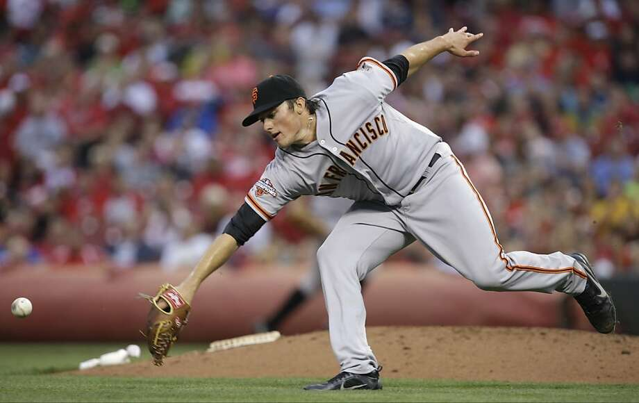 San Francisco Giants starting pitcher Michael Kickham can't reach an infield single hit by Cincinnati Reds' Joey Votto in the third inning of a baseball game, Monday, July 1, 2013, in Cincinnati. (AP Photo/Al Behrman) Photo: Al Behrman, Associated Press