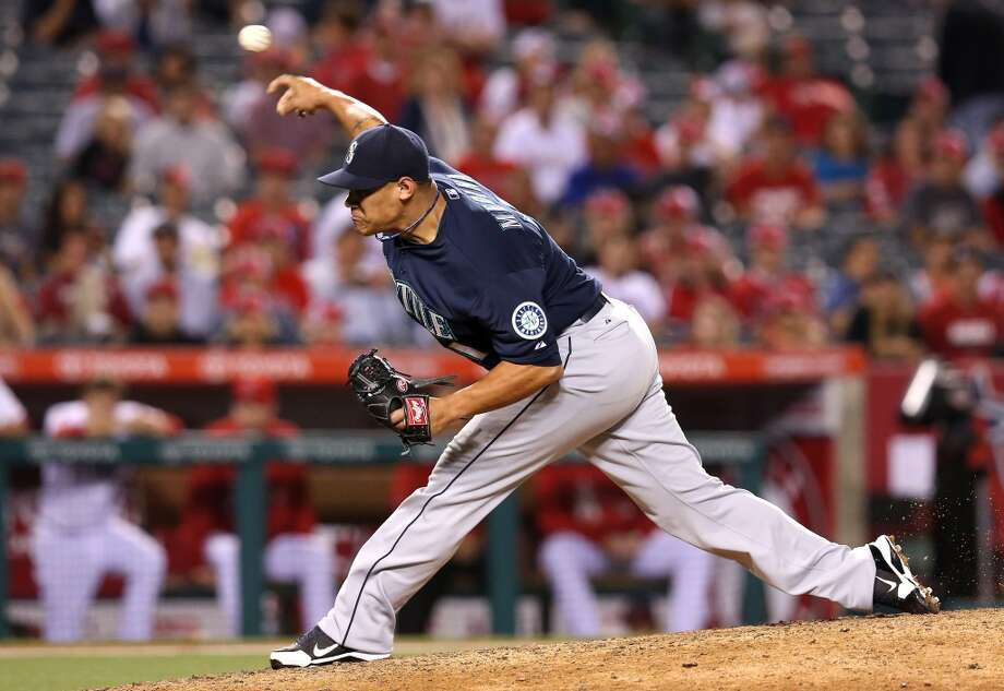 Yoervis Medina | Grade: B+  right-handed pitcher  Only 24 years old, Yoervis Medina has been a silver lining in a bullpen that has seen its fair share of disappointment this season. The Venezuelan right-hander has performed admirably as the Mariners' hard-throwing set-up man at times this season. With the closer role still up for grabs, Medina may have a chance to win that spot in the second half.  ERA: 2.76 | Record: 3-2 | Games: 28 | Innings: 29.1 Hits: 22 | Strikeouts: 29 | Walks: 18 | Earned runs: 9