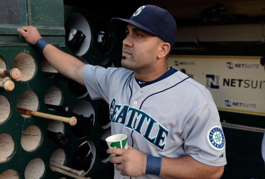Kendrys Moralez | Grade: A- designated hitter  Morales may never be the superstar he was developing into for the Angels before injuring himself, but he could be on the path. He has been a strong hitter for the Mariners this season, and though like many M's has battled injuries, could be someone the team might want to lock up before he becomes a free agent at the end of the year. If possible.  Average: .277 | On-base: .334 | Slugging: .433 | At-bats: 300 | Games: 78 Hits: 83 | RBI: 42 | Strikeouts: 59 | Doubles: 20 | Triples: 0 | Home runs: 9  Photo: Thearon W. Henderson, Getty Images / 2013 Thearon W. Henderson