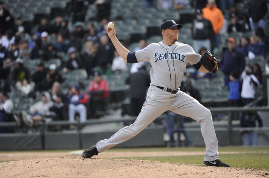 Stephen Pryor | Grade: incompleteright-handed pitcherPryor appeared in seven early games before tearing a muscle in his back, and hasn't been back since. The M's could use his high heat on the mound, but they'll have to wait until he's healthy. As such, he gets an ''incomplete.''  ERA: 0.00 | Record: 0-0 | Games: 7 | Innings: 7.1 Hits: 3 | Strikeouts: 7 | Walks: 1 | Earned runs: 0  Photo: Ron Vesely, MLB Photos Via Getty Images / 2013 Major League Baseball Photos