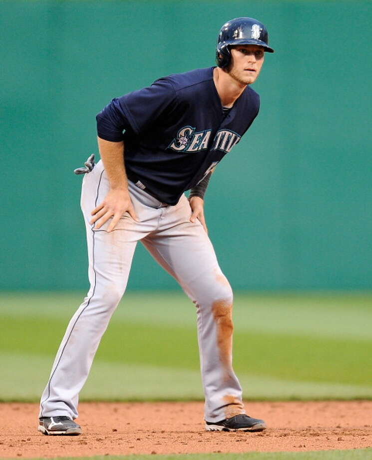 Michael Saunders | Grade: DoutfielderThe Mariners expected big things out of Saunders this season, particularly after his great showing for Canada in the World Baseball Classic. But he's been slumping all year with just about no clutch dependability. If the M's had all of their outfielders healthy, Saunders would probably be in Triple-A right now.  Average: .211 | On-base: .296 | Slugging: .320 | At-bats: 194 | Games: 60 Hits: 41 | RBI: 15 | Strikeouts: 60 | Doubles: 7 | Triples: 1 | Home runs: 4  Photo: Joe Sargent, Getty Images / 2013 Getty Images