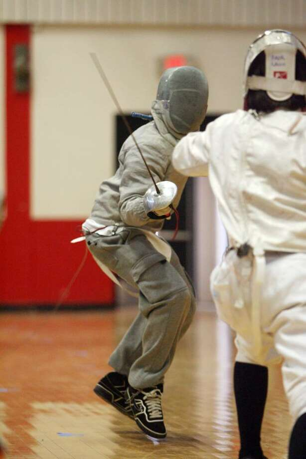 Central High School's Jan Cajas, left, competes against Clarkestown, Max shubin during a saber bout in The 1st Annual Novice and Junior Varsity Epee and Saber Tournament hosted by Central on Saturday, Jan. 16, 2010. Photo: B.K. Angeletti / Connecticut Post