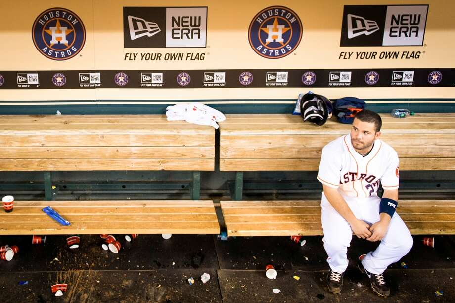July 1: Rays 12, Astros 0 Astros second baseman Jose Altuve sits alone in the dugout after the Astros 12-0 loss to the Rays.