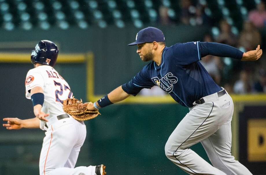 Rays first baseman James Loney tags out Astros second baseman Jose Altuve as he is caught in a rundown during the first inning.