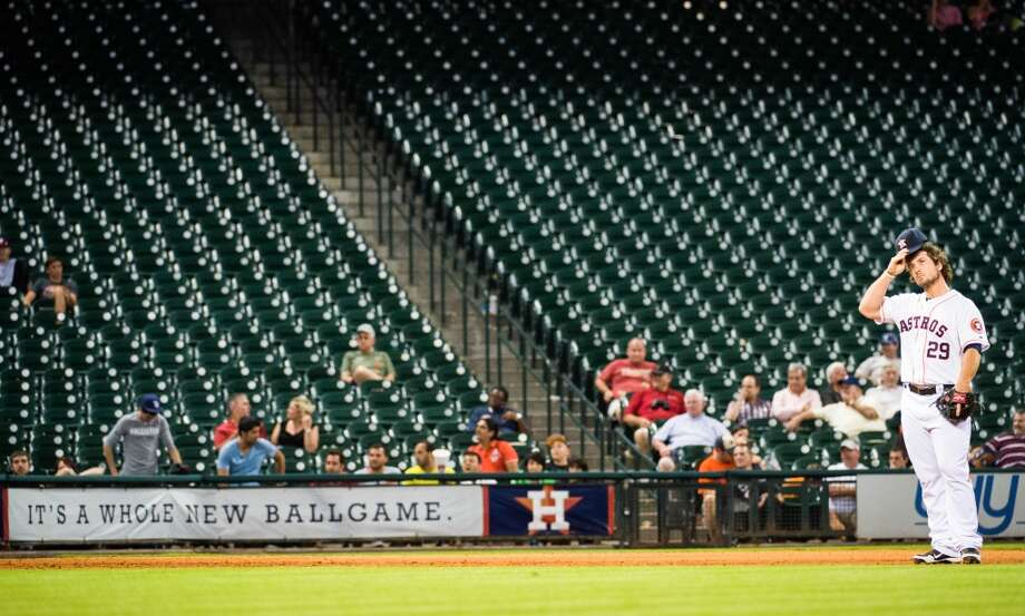 A scarce few fans are left to watch Brett Wallace play third base during the ninth inning.