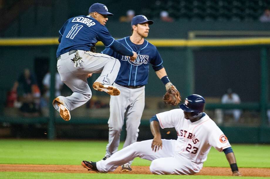 Tampa Bay shortstop Yunel Escobar makes the relay over Astros first baseman Chris Carter as he turns a double play during the fourth inning.