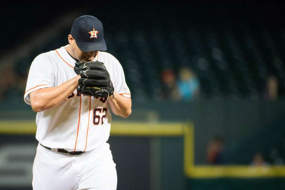 Astros pitcher Hector Ambriz reacts after giving up a run during the eighth inning.