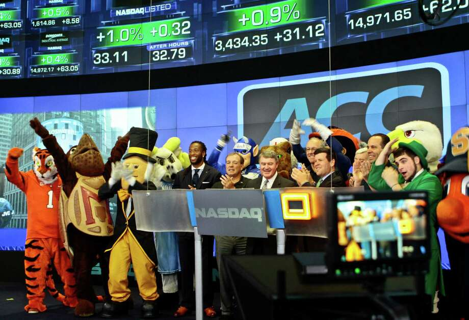 Atlantic Coast Conference mascots join ACC and NASDAQ officials for the ringing of the closing bell on Monday, July 1, 2013 in New York.  The Atlantic Coast Conference officials and coaches visited the NASDAQ Market Site in Times Square to officially announce the addition of its three new members in Notre Dame, Pitt and Syracuse. Photo: Bethan McKernan