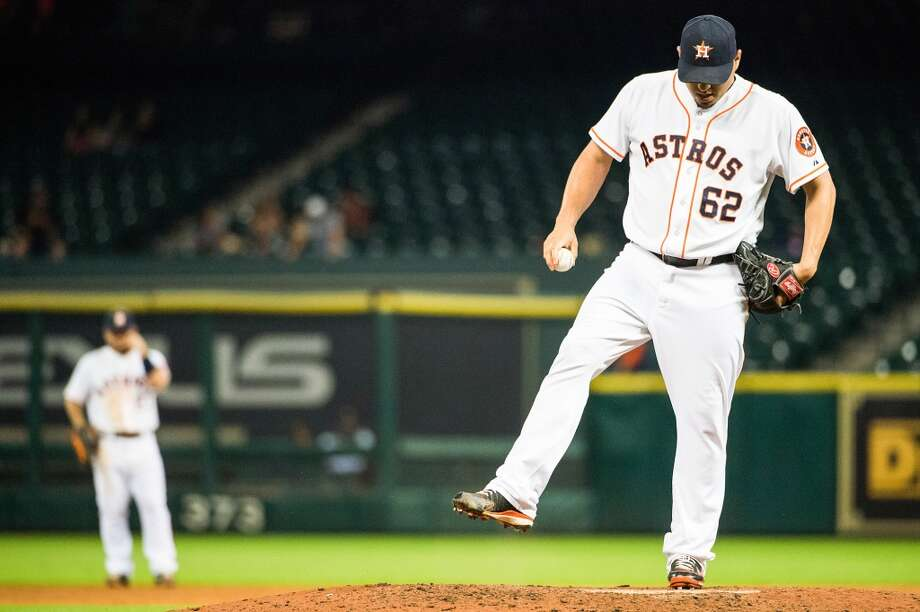 Astros relief pitcher Hector Ambriz kicks at the mound after giving up run.