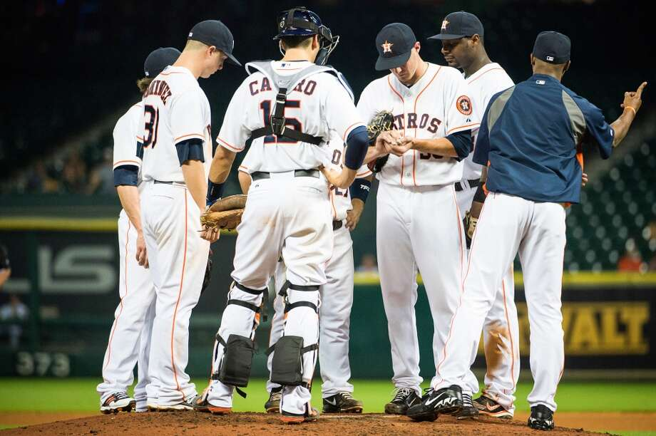 Astros manager Bo Porter calls to the bullpen as relief pitcher Paul Clemens leaves the game.