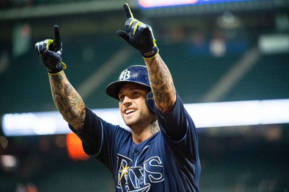 Rays third baseman Ryan Roberts celebrates after hitting a home run during the eighth inning.