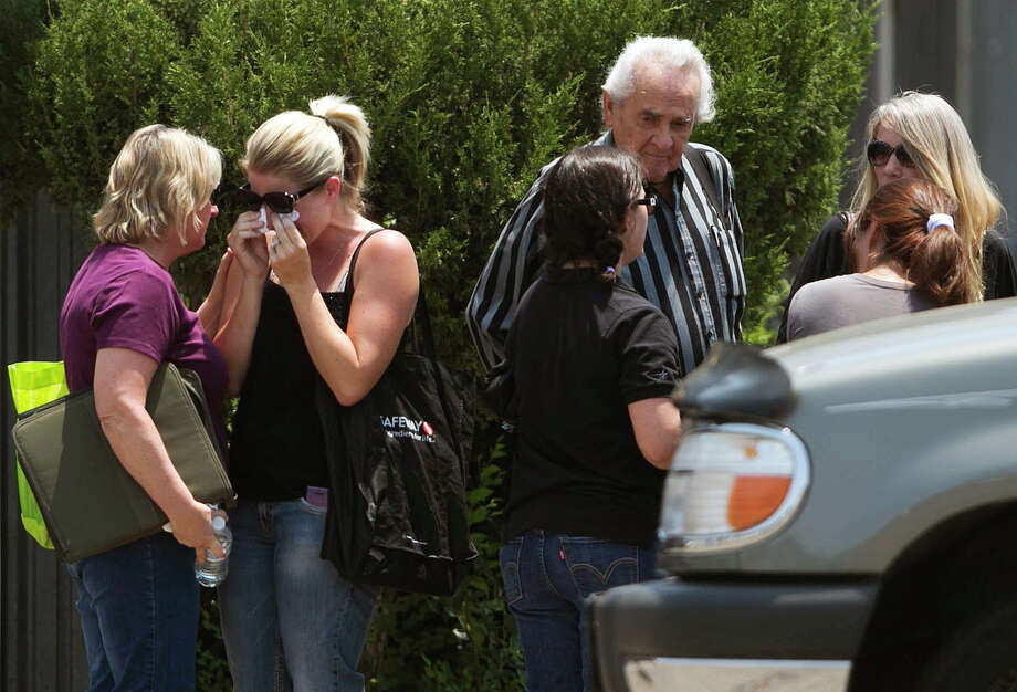 Families gather at the fire station Monday, July 1, 2013, in Prescott, Ariz., where an elite team of firefighters was based. Nineteen of the 20 members of the team were killed Sunday when a wildfire suddenly swept toward them in Yarnell, Ariz. (AP Photo/The Arizona Republic, Patrick Breen) Photo: Patrick Breen, Associated Press / The Arizona Republic