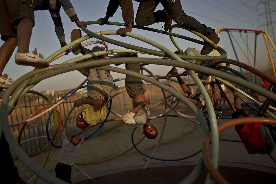 South African children play in a public park in Soweto township on the outskirts of Johannesburg, South Africa, Monday, July 1, 2013. (AP Photo/Muhammed Muheisen) Photo: Muhammed Muheisen, Associated Press