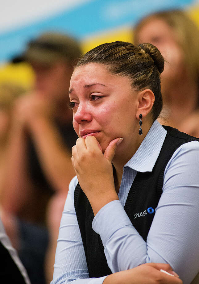 Gina Martinez, who knows members of the Granite Mountain Hot Shot crew that died, cries while listening to a news conference at Prescott High School, Monday, July 1, 2013, about the tragedy that took the lives of 19 members of the Granite Mountain Hot Shot crew, Sunday. (AP Photo/The Arizona Republic, Tom Tingle) Photo: Tom Tingle, Associated Press / The Arizona Republic