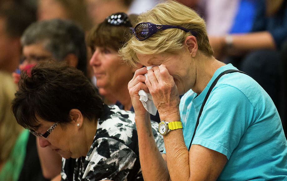 Toni Tennille,  Prescott, whose home was saved by firefighters, cries listening to a news conference at Prescott High School, Monday, July 1, 2013, about the tragedy that took the lives of 19 members of the Granite Mountain Hot Shot crew, Sunday. (AP Photo/The Arizona Republic, Tom Tingle) Photo: Tom Tingle, Associated Press / The Arizona Republic