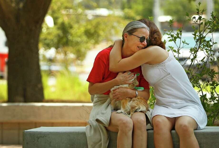 Alora Slemboski, right,  consoles Nancy Myers, outside the Red Cross Shelter, Monday, July 1 2013 in Prescott, Ariz. Myers fears she lost her home in the Yarnell Hill Fire. (AP Photo/The Arizona Republic, David Kadlubowski) Photo: David Kadlubowski, Associated Press / The Arizona Republic