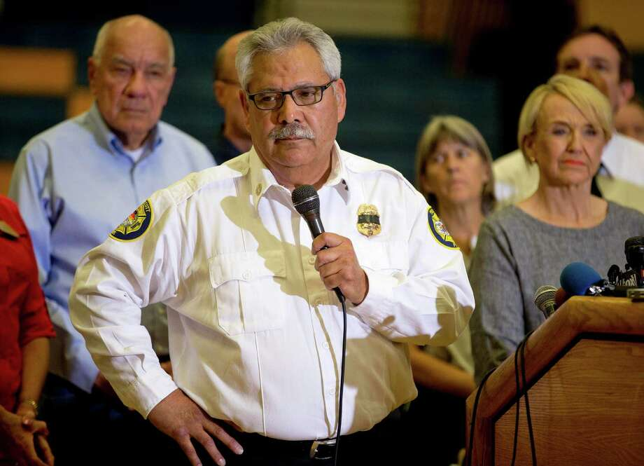 Prescott Fire Chief Dan Fraijo answers questions during a news conference, Monday, July 1, 2013 in Prescott, Ariz. The bodies of 19 members of an elite firefighting crew killed after being overrun by an Arizona wildfire have been retrieved from the mountain where they died. Fraijo now says all 19 were from the Prescott-based Granite Mountain Hotshots. Authorities earlier said one of the men wasn't a crew member.  (AP Photo/Julie Jacobson) Photo: Julie Jacobson, Associated Press / AP